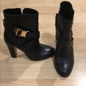 Black booties with buckle detailing